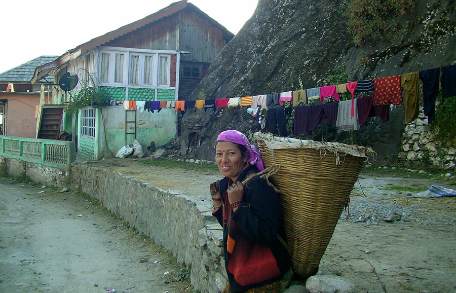 A lady goes about her chores in Raison village